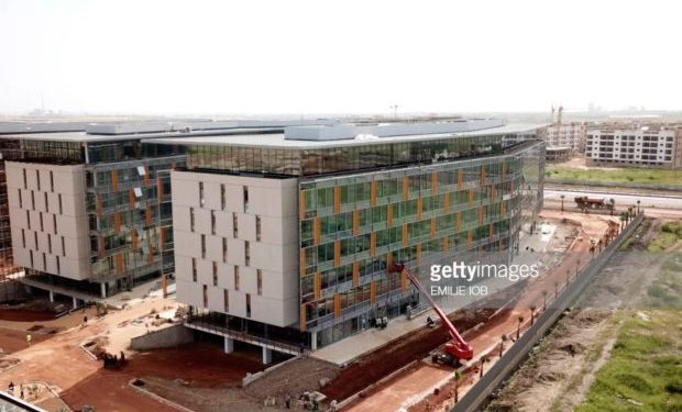 An aerial view taken on October 17, 2018 shows residential buildings on a construction site for the project of new city in Diamniadio, 40 kms on the outskirts of Dakar. (Photo by EMILIE IOB / AFP) (Photo credit should read EMILIE IOB/AFP/Getty Images)