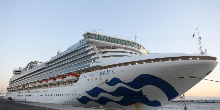 """YOKOHAMA, Feb. 6, 2020 -- Photo taken on Feb. 6, 2020 shows the """"Diamond Princess"""", a cruise ship which has been kept in quarantine at the port of Yokohama in Japan. Test results show that nine passengers and a crew member on a cruise ship quarantined off the coast in Japan are infected with the novel coronavirus, the Japanese health ministry said Wednesday. (Photo by Du Xiaoyi/Xinhua via Getty) (Xinhua/Du Xiaoyi via Getty Images)"""